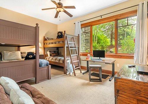 A102 Hummingbird Lodge kids bedroom with bunk beds and computer desks.