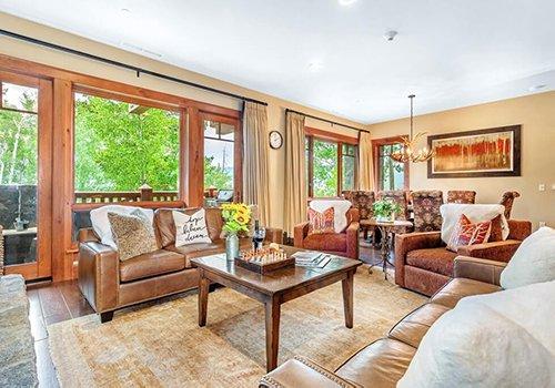 A102 Hummingbird Lodge living room with large windows.